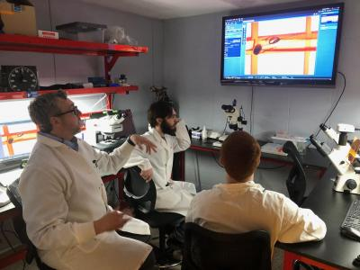 Bluefield State College faculty member Dr. James Walters (left) and two BSC students observed enhanced microscope images in the new Southern WV Imaging Core Facility at the College.