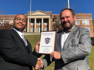 "Bluefield State College Professor of History Dr. Rodney Montague (left) was selected to BSC's faculty as the College's ""Faculty of the Year, 2019-2020"" award recipient.  He is pictured with Dr. Ted Lewis (right), Bluefield State College Provost, who formally presented the award."