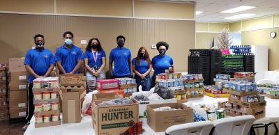 With community and campus support, the Emerging Leaders Institute recently delivered more than 470 nonperishable food items to the Bluefield Union Mission.   Pictured (left-to-right) are Bluefield State College Emerging Leaders Institute members Desmond Freeman; Brandon Anyanwu (ELI President), Raenel Crenshaw, Bassy Sissoko, Autumn Miller, and Ashlei Kelly (ELI Secretary).  BSC faculty member Linda P. Trigg is ELI's Director.