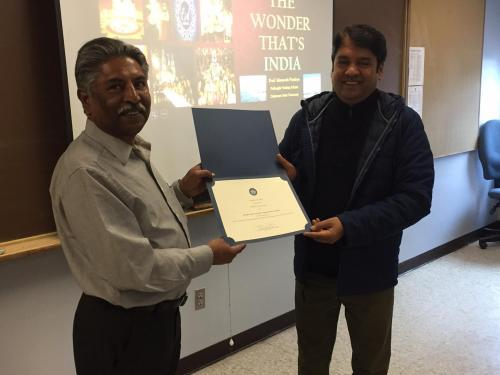 Fulbright Visiting Scholar Maneesh Pandeya (right) receives a certificate of appreciation from Dr. Sudhakar Jamkhandi, Coordinator of International Initiatives at Bluefield State College, prior to a recent presentation at BSC.