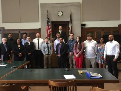 "Bluefield State College Criminal Justice program students in Professor Mike Lilly's ""Criminal Procedures and Evidence"" class are pictured as they participated in a recent mock trial competition in the courtroom of Mercer County Circuit Court Judge William Sadler (standing center-second row).  This year's competition was the 28th annual BSC CJ mock trial to take place at the Mercer County Courthouse."